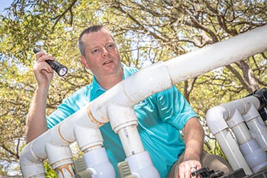 Dave Fahrenthold from Exactual Inspection Services inspecting the plumbing for a pool.